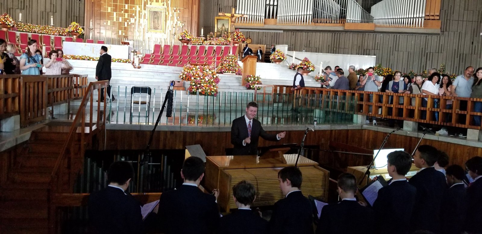 Image: Boy Choristers of Saint Paul's sing the Mass before the tilma bearing the image of Our Lady of Guadalupe.